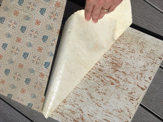 dated shelf paper being peeled off of wooden shelf