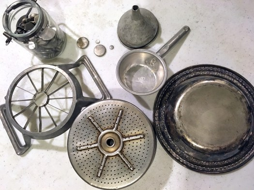 Aluminum coffee filter basket, apple corer, funnel, measuring cup, silver tray and small metal pieces