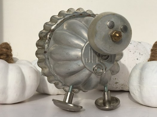 Junk turkey assemblage made from old Jell-O mold, miniature tart mold, old knobs and other metal parts
