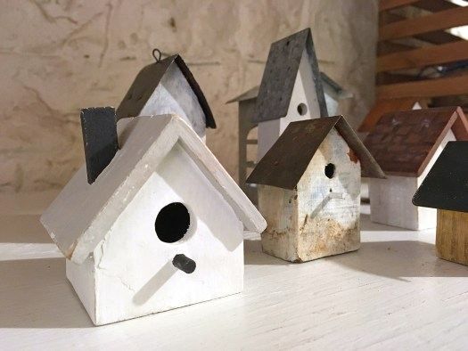mini birdhouses before being transformed into a mini Christmas village