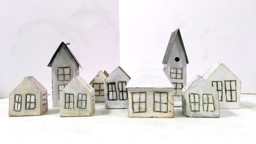 Little white houses in a Christmas village display