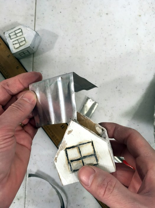 attaching a tin roof to mini house