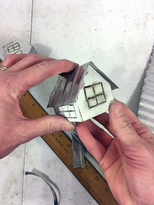 mini white wooden house with tin roof