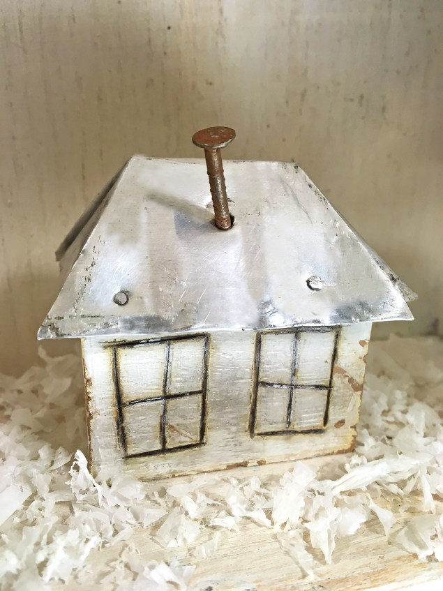 four-sided mini house with a nail chimney