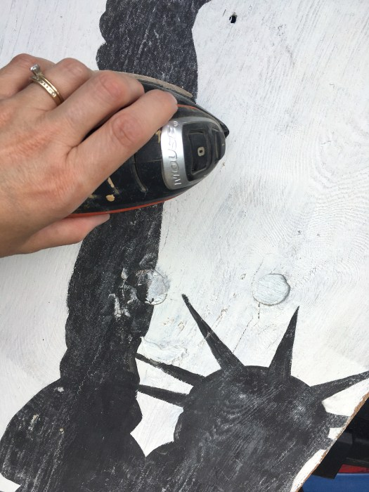 Sander roughing up Statue of Liberty silhouette to age it