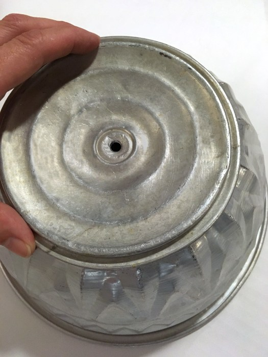 aluminum lid on top of Bundt pan