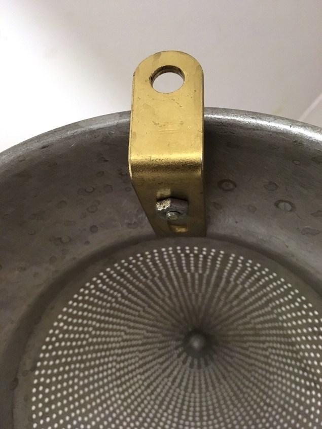 L bracket to attach binoculars to colander