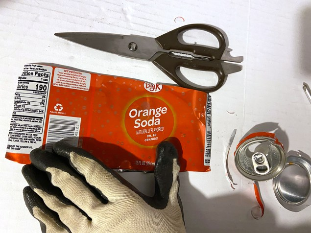 flattened orange soda can