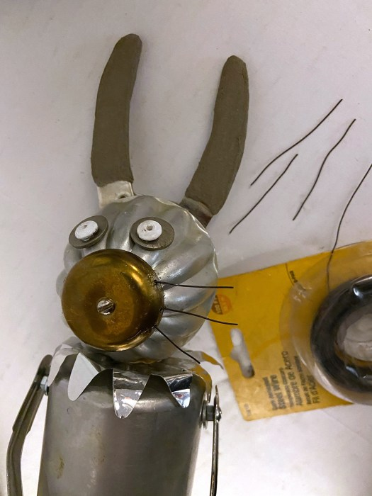 adding wires to junk bunny's face to make whiskers