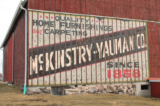 closeup of full-size McKinstry-Yauman Co. sign on a real barn
