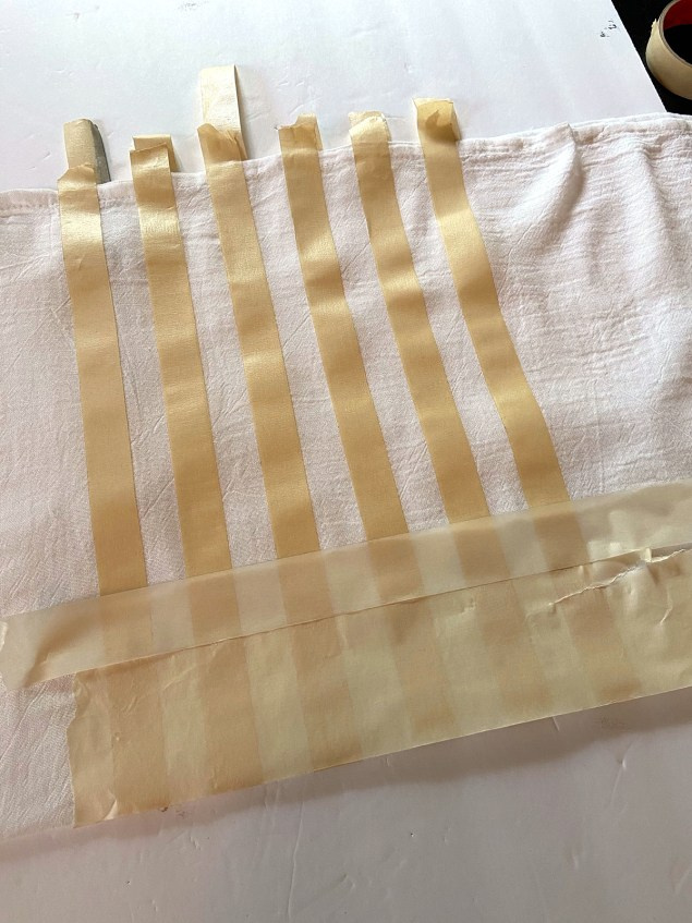 flag design made in masking tape on flour sack dishtowel