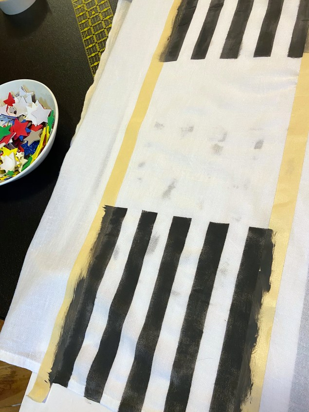 black stripes on white dishtowel