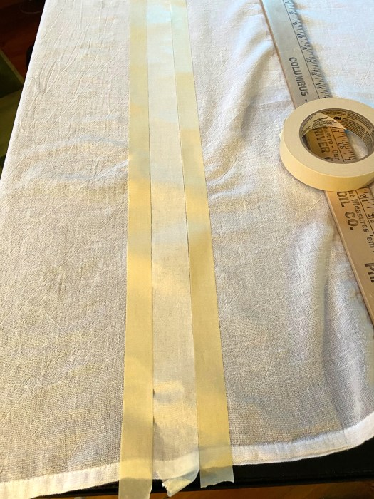 use masking tape to mark off stripes for patriotic dishtowels