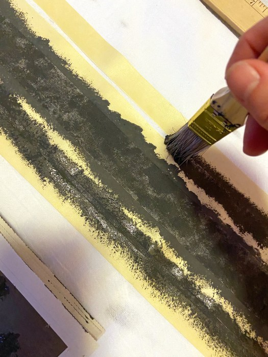 painting black grain sack stripes on kitchen towel