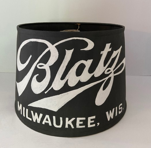 vintage inspired painted lampshade with Blatz beer logo in white letters on a black background