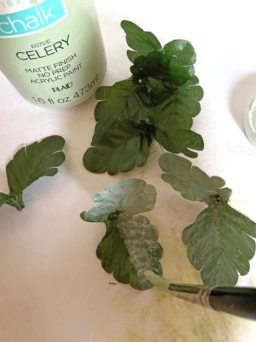 Painting artificial flower leaves with green chalk paint