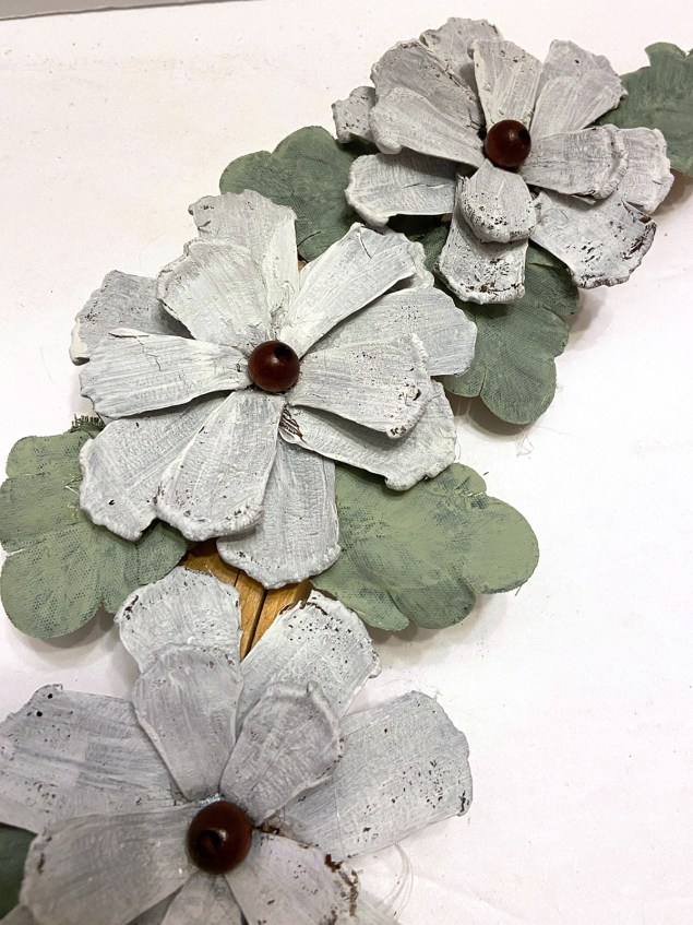 White flowers made from pinecone scales