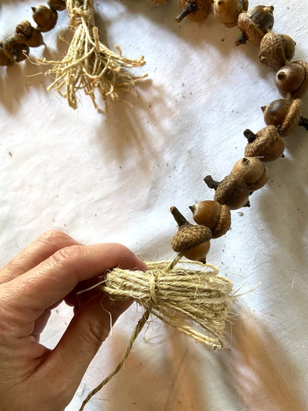 feeding the tail of the garland through the loops
