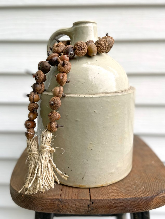 acorn garland wrapped round old jug