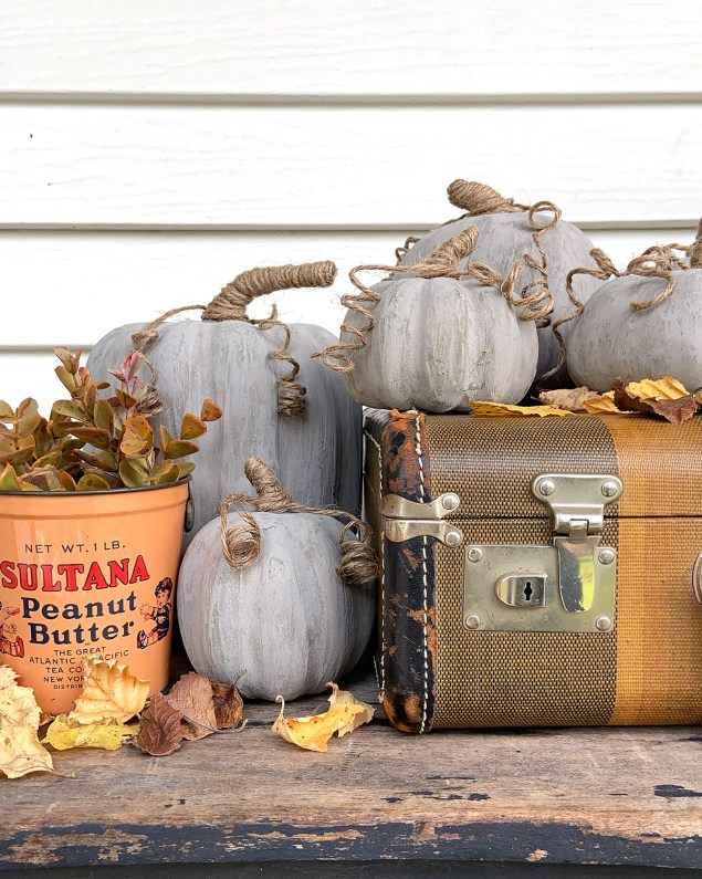 diy concrete pumpkins in a fall vignette