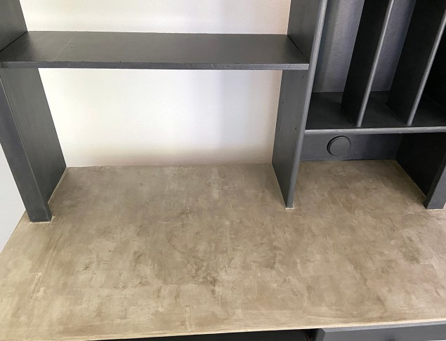 industrial farmhouse style desk with concrete top after clear wax had been applied