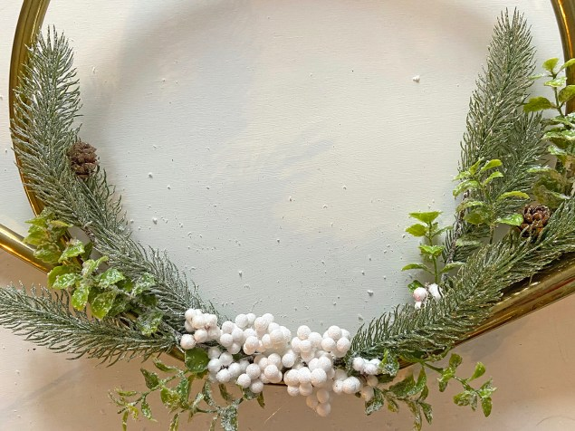French horn wreath with pine boughs and white berries