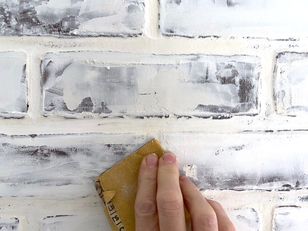 sanding bumps and ridges off the joint compound on the wall