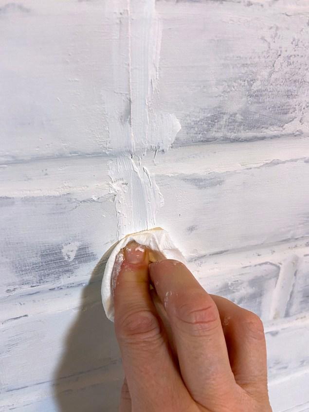 applying Flex Paste to a seam between paneling