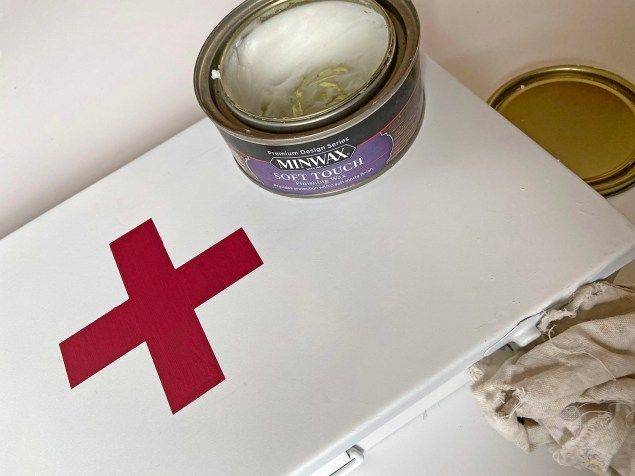 waxing the vintage inspired first aid box with clear furniture wax and a lint-free rag