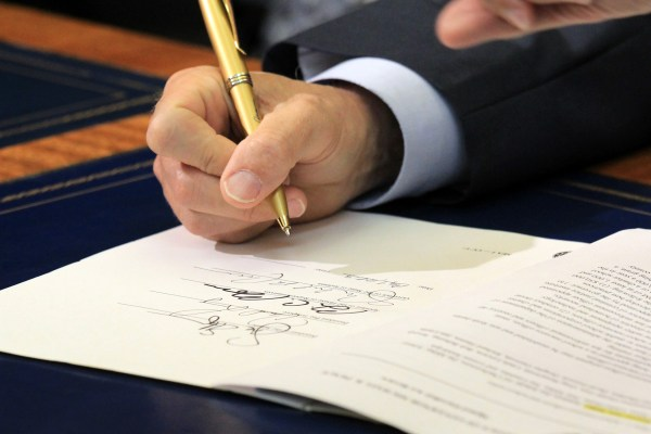 signing the bill into law