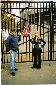 Vickie Eiden, pictured with father Raymond Eiden at UW-Madison's Camp Randall Stadium, found comfort in attending meetings at a local support group after her father's suicide. Talking openly about suicide helps to break down the stigma associated with suicide, prevention advocates say. CONTRIBUTED PHOTO
