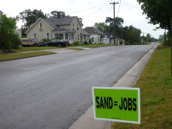 A yard sign declares support for the sand mining industry in Mondovi, Wis. Several mines are in development in this small town in northern Buffalo County. June 14, 2012.