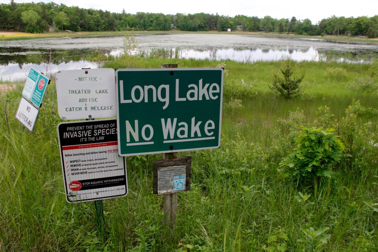 The boat launch at Long Lake, near Plainfield, no longer reaches the water. In Wisconsin's Central Sands, some lakes and streams have lowered or dried up in recent years as the number of high-capacity wells has mushroomed, largely for irrigation.