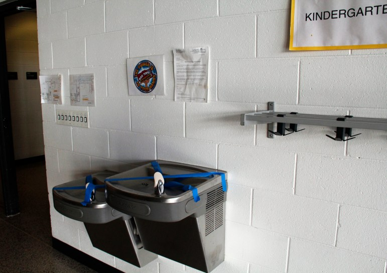 Water fountains are taped over at Yorkville Elementary School in Racine County due to high levels of the metal molybdenum. Clean Wisconsin alleges that coal ash buried in a school construction site is partly to blame.
