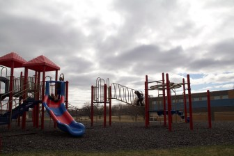 Children play behind the Dane County Boys and Girls Club in Fitchburg. Some young people at the club in the Allied Drive neighborhood have had experiences with guns.
