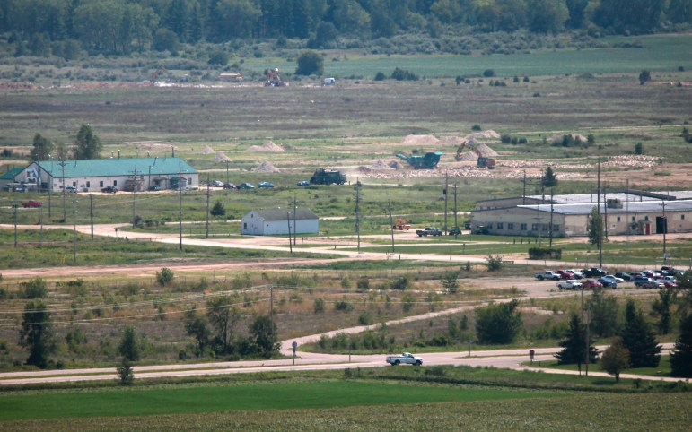 An aerial view looking east shows the grounds of the Badger Army Ammunition Plant near Baraboo in 2012. The Army continues to clean up groundwater pollution left by the now-defunct manufacturing plant and has proposed building a drinking water system for about 400 nearby homes whose wells are tainted or at risk of contamination.