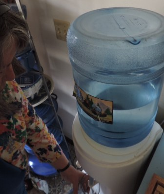 """Mary Jane Koch, who lives near the shuttered Badger Army Ammunition Plant, has been using bottled water for drinking and cooking at her home for 11 years since ethyl ether, a solvent, turned up in the Kochs' private well water. """"It is very inconvenient having to get the water from the water cooler,"""" Koch said. """"Finding a place for the cooler and changing the water jugs is a challenge."""""""