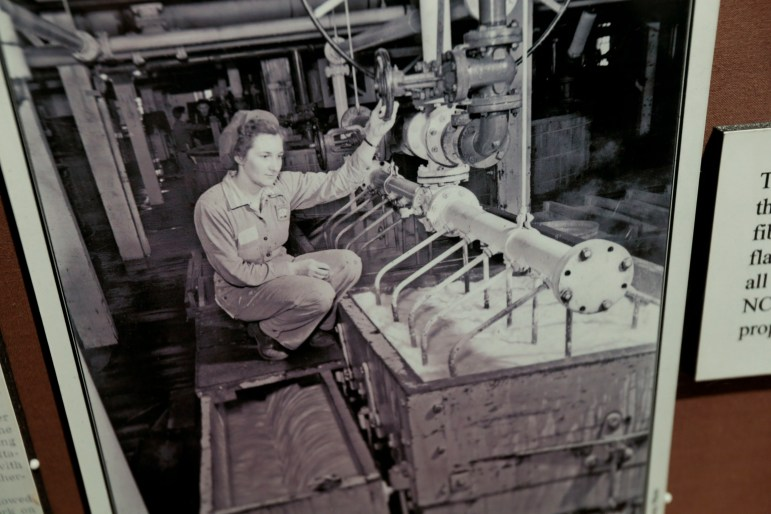 A photo on display at the Museum of Badger Army Ammunition shows a woman working with nitrocotton slurry at the facility. Decades of ammunitions manufacturing at the plant left a legacy of polluted groundwater. The Army has been cleaning up the aquifer and soil for years and has proposed spending an estimated $40 million to provide a source of clean drinking water to about 400 area homes.