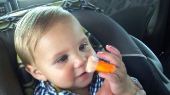 Casheous, then 9 months old, examines his finger after a test that showed the level of lead in his blood was more than three times the federal threshold for poisoning. His mother, Crystal Wozniak, has become an advocate for blood testing children for lead, which can cause lower IQ and behavior changes.
