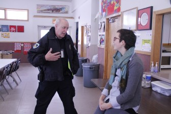 Madison Police Officer David Dexheimer chats with Grace Moran, the middle and high school coordinator at the Vera Court neighborhood center, during a January visit. Dexheimer stays in contact with Moran and Alison Stauffacher, the elementary school coordinator, about safety in the neighborhood.