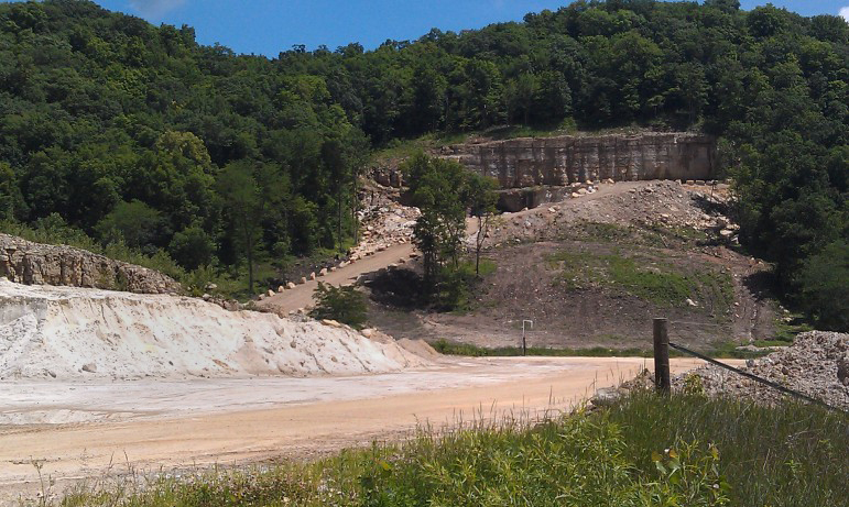 An entrance on the west end of the Pattison Sand Co. site in rural Clayton County, Iowa, is seen in 2014. The company's mining facility in Iowa has received more workplace violations than any other industrial sand mine in the United States, according to data from the Mine Safety and Health Administration.