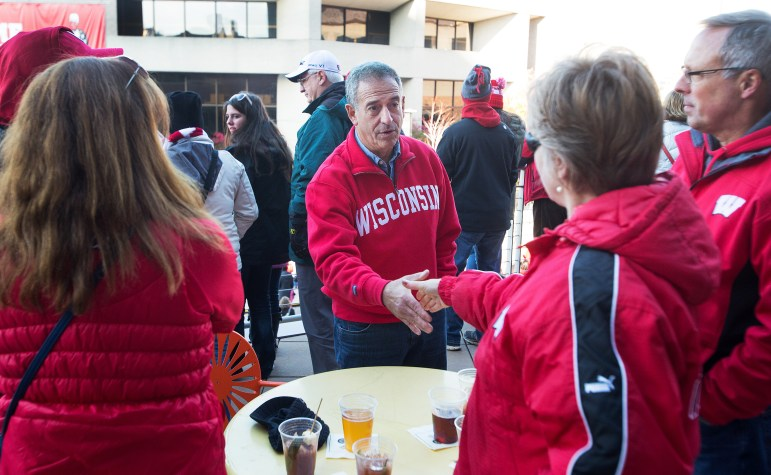 Former U.S. Sen. Russ Feingold works the crowd at Union South before the start of the Badger football game against the Purdue Boilermakers, Oct. 17, 2015 at Camp Randall Stadium. Feingold, a Democrat, is trying to regain the U.S. Senate seat he lost to Republican Ron Johnson six years ago.