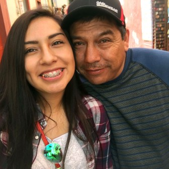 """Beloit (Wis.) Memorial High School senior Andrea Montes, seen here with her father, Manuel, looks forward to voting for the first time this year. Montes, a member of the school's varsity soccer team, says she is motivated by a racially charged incident at a game in Elkhorn in which opposing fans chanted """"Build that wall!"""" at Latina members of Beloit's junior varsity squad. Montes' family is originally from Mexico."""