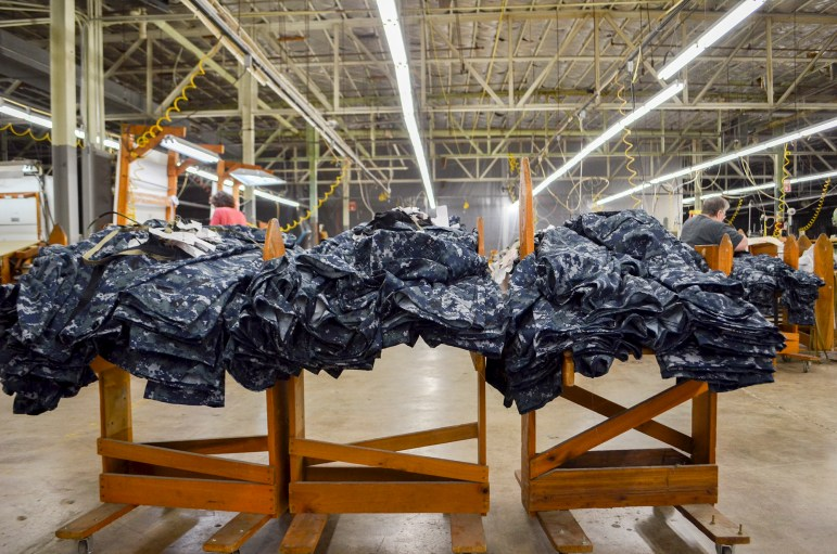 Racoe Inc., a military fabric cutting company, moved into the old OshKosh B'gosh factory in December 1997 in Celina, Tenn. Only six people now work in the 66,000-square-foot building that once employed up to 2,000 people. As the county's economy struggles, many historically Democratic voters are switching to the Republican Party.