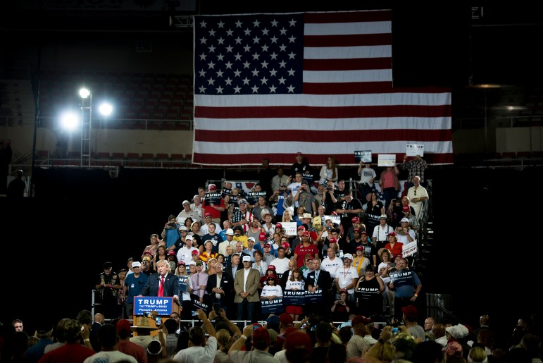 """Republican presidential candidate Donald Trump holds a rally in Phoenix. Trump has claimed fraudulent voters will be able to cast multiple ballots unless states enact voter ID laws, predicting that the Nov. 8 election will be """"rigged."""""""
