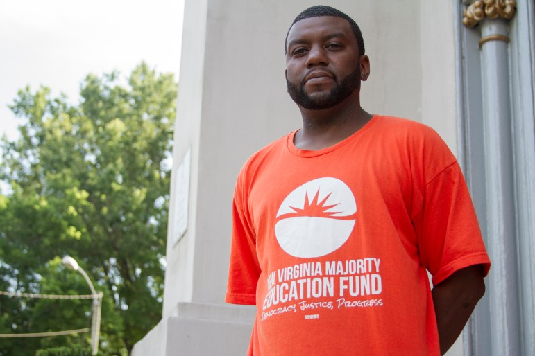 As a staff member with the New Virginia Majority Education Fund, Brandon Polly reaches out to felons living in and around Norfolk, helping them understand their rights and navigate the re-enfranchisement process.