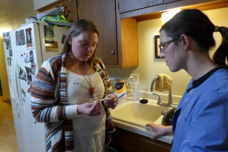 Crystal Wozniak, left, shows Green Bay homeowner Jackie Grant how to test her home for lead hazards. After she learned her own son was lead poisoned in 2013, Wozniak made it her mission to spread awareness about the presence of lead in households.