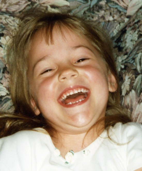 Karen, daughter when she was small, laughing