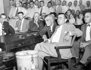Gov. Coke Stevenson (holding cigar) at the hearing in Alice.