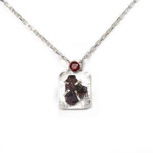 Handmade garnet pendant set in sterling silver with faceted garnet and garnet crystal